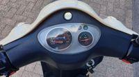 VERKOCHT....Novox C20 beige elektrisch 25 km/h